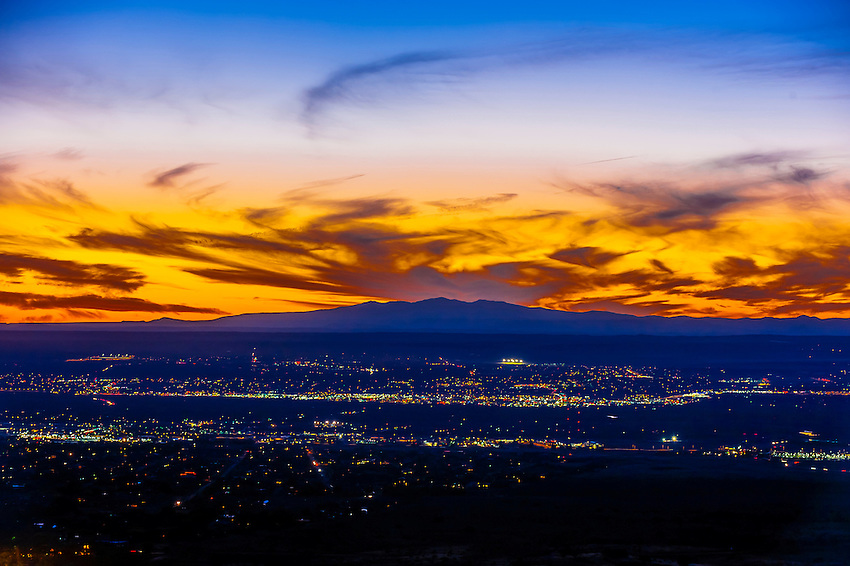 A fiery sunset with 11,306 foot (3,446 meters) Mount Taylor in background, Albuquerque, New Mexico USA