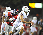 Ole Miss defensive end Channing Ward (11) chases Texas'  David Ash (14) at Vaught-Hemingway Stadium in Oxford, Miss. on Saturday, September 15, 2012. Texas won 66-21. Ole Miss falls to 2-1.