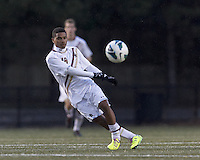 Boston College forward/midfielder Zeiko Lewis (19) clears the ball. Boston College (white) defeated Harvard University (crimson), 3-2, at Newton Campus Field, on October 22, 2013.