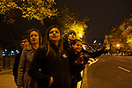 George Washington University students Zach Montellaro, from left, Shanna Helf, Hannah Flom, Tim Stackhouse and Laura Longman, all 18, look down 15th Street NW in Washington, D.C. to catch a glimpse of President Barack Obama's motorcade as he returned to Washington from Chicago on Wednesday evening. Each of the students voted for the first time in this year's eleciton.