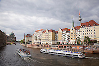 The River Spree flows past the Nikolai quarter of former East Berlin - restored in the 1980s by the East German government for the city's 750th anniversary. Before the Wall came down it was the most sought after residential area in the East, inhabited by Stasi agents and others with good government connections. In the background is the dome of the Berlin Cathedral.