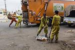 10/10/2014 -- Kirkuk, Iraq -- Bangladeshi workers clean the Rzagari neighborhood.