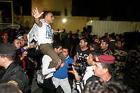 Freed Palestinian prisoners are greeted at the headquarters of Palestinian President Mahmoud Abbas in the West Bank city of Ramallah, August 14, 2013. The release of 26 prisoners, all but one of whom were jailed before the Palestinian Authority was formed in 1994, has been hailed by Palestinian negotiators but has incensed some Israeli officials.  Photo by Oren Nahshon