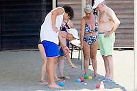 Roma 16 Luglio 2013<br /> Le vacanze solidali allo stabilimento balneare &ldquo;L&rsquo;Arca&rdquo; di Ostia<br /> Lo stabilimento balneare &ldquo;L&rsquo;Arca&rdquo; di Ostia  dalla Caritas diocesana di Roma, <br /> &egrave;  una struttura per vacanze attrezzata  pensate per famiglie con bambini ed anziani. In essa ogni giorno, a turni settimanali, sono ospitati 250 anziani seguiti dai servizi sociali dei municipi, e alcuni degli ospiti dei centri Caritas. Anziani e volontari giocano a bocce<br /> The bathing establishment &quot;The Ark&quot; of Ostia from Caritas of Rome,<br /> is a structure equipped for holidays suitable for families with children and the elderly. In it every day, at weekly shifts, are housed 250 elderly followed by social services in the municipalities, and some of the guests of Caritas centers. Elders and volunteers at play boules