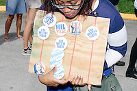 A woman sells pro-Clinton campaign buttons to people waiting to enter a campaign rally for Democratic presidential nominee Hillary Clinton in the Theodore R. Gibson Health Center at Miami Dade College-Kendall Campus in Miami, Florida, USA. Former Vice President Al Gore also spoke at the rally.