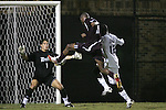 05 October 2007: Boston College's Sherron Manswell (8) takes a shot against Duke goalkeeper Justin Papadakis (1). Boston College defeated Duke University at Koskinen Stadium in Durham, North Carolina in an NCAA Men's soccer game.