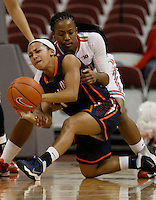 Ohio State Buckeyes guard Ameryst Alston (14) pressures Tennessee Martin Skyhawks guard Heather Butler (11) in the second half at Value City Arena in Columbus Dec. 17, 2013.(Dispatch photo by Eric Albrecht)