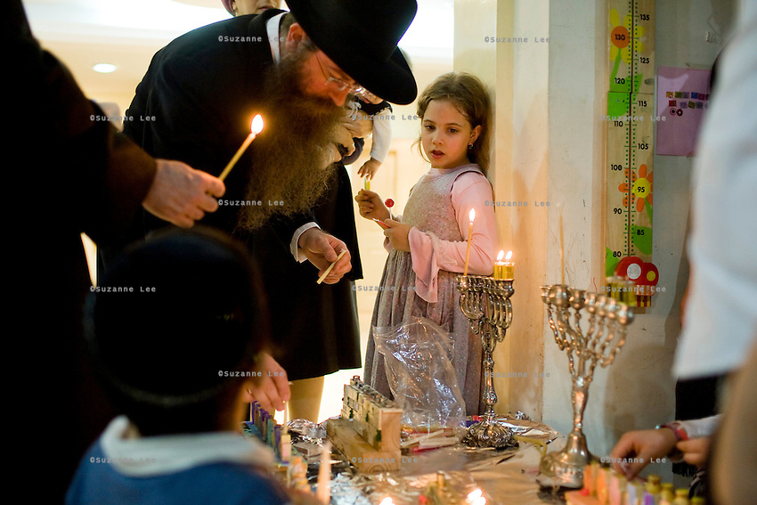 Rabbi Wilhelm (3rd from left) and his family gather to light candles and celebrate  Chanuka in their home in Chabad Bangkok (Khao San road), Thailand during Chanuka celebrations on 12th December 2009..Photo by Suzanne Lee / For Chabad Lubavitch