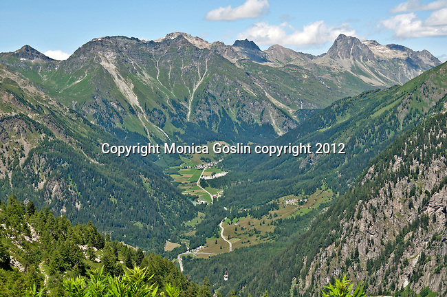 View of the Bregaglia Valley in Switzerland and the funicular that takes you to the Albigna dam, one of over 150 dams in the country; The Albigna dam sits at 2,163 meters elevation; See the small white cable car in the bottom middle of the image