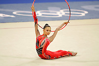 Aliya Yussupova competing for Kazakhstan...handling on carpet with hoop during All-Around final at Athens Olympic Games on August 29, 2004 at Athens, Greece. (Photo by Tom Theobald)