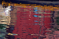 Reflections of the colorful Ghats on the Ganges River, Varanasi India