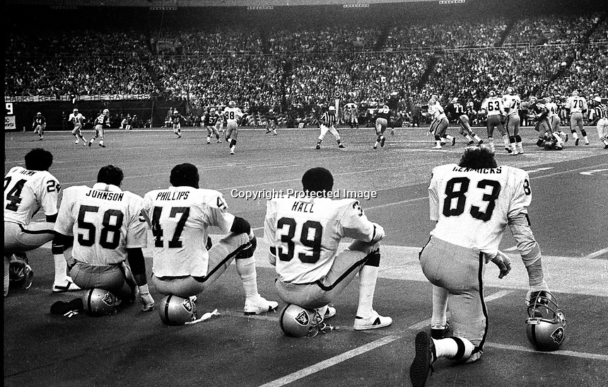 Oakland Raiders linebackers wait for the offense sitting on the sideline in the Seattle superdome. (1978 photo by Ron Riesterer)