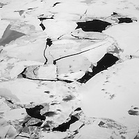 Drifting ice sheets in the sea South of Thule Air Base. Thule Air Base was established as an American military base in 1951 and is the US Air Force's northernmost base. During the cold War it employed over 10,000 people, mainly serving as a landing and refuelling strip for American bombers, lying halfway between the US and the Soviet Union's industrial heartland via the North Pole. Today, around 550 people work at the base with another 400 Danish and Greenlandic civilian staff.