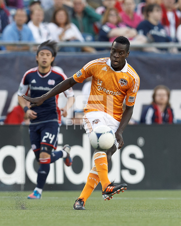 Houston Dynamo midfielder Je-Vaughn Watson (10) passes the ball. In a Major League Soccer (MLS) match, the New England Revolution tied Houston Dynamo, 2-2, at Gillette Stadium on May 19, 2012.