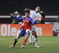 Costa Rica forward Bryan Ruiz (11) fights for possession of the ball against USMNT defender Oguchi Onyewu (5)   The USMNT tied Costa Rica 2-2 on the final game of the 2010  FIFA World Cup Qualifying round at RFK Stadium,Wednesday  October 14 , 2009.