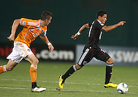 Andy Najar #14 of D.C. United races away from Geoff Cameron #20 of the Houston Dynamo during an MLS match at RFK Stadium in Washington D.C. on September  25 2010. Houston won 3-1.
