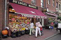 Shoppers on sidewalk in front of De Lucas Market and Deli on Charles Street on Beacon Hill Boston MA