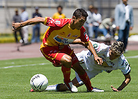 UNAM Pumas forward Jose Luis Lopez is fouled by UAG Tecos defender Juan Antonio Huerta during their soccer match,  March 19, 2006 at the University Stadium in Mexico City. UAG Tecos won 1-0 to UNAM Pumas. Photo by © Javier Rodriguez