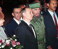 "Cuban President Fidel Castro, welcomes the president of the Russian Federation, Vladimir Putin at ""Jose Martí International Airport during Putin's Official three day visit to Cuba. This is the first russian president that visits the island. December 13, 2000. . Credit: Jorge Rey/MediaPunch"