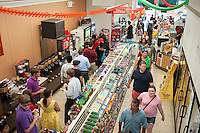 Hordes of customers line up for their free Slurpees  in a 7-Eleven store in New York on Friday, July 11, 2014 (7-11, get it?), Free Slurpee Day! The chain has been giving away free 7oz Slurpees for the past twelve years on July, 11, which it has adopted as its corporate birthday. The popular icy, slushy, syrupy drinks are available in regular and diet flavors, in combinations, and the stores have stocked up with extra barrels of syrup to meet the expected demand. The 87 year old chain expects to serve over 7 million Slurpees today. (© Richard B. Levine)