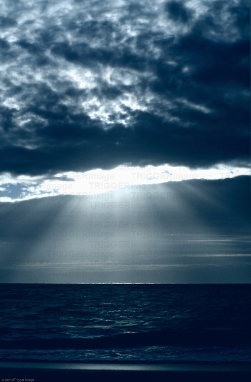 Dramatic lightrays through ocean clouds.