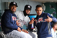 Colorado Springs Sky Sox pitcher Junior Guerra (37), third baseman Garin Cecchini (7) and shortstop Orlando Arcia (2) pose for a photo in the dugout prior to a Pacific Coast League game against the Iowa Cubs on May 1st, 2016 at Principal Park in Des Moines, Iowa.  Colorado Springs defeated Iowa 4-3. (Brad Krause/Four Seam Images)