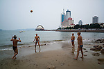 Men play volleyball on beach No. 2 in the center of old Qingdao. Qingdao is a well known destination among Chinese due to its beaches and moderate climate.