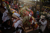 """People attend the traditional """"Silletero"""" parade during the Flower Festival in Medellin August 7, 2012. Photo by Kena Betancur / VIEW."""