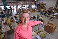 Portrait of Aurora Natural Founder Stephanie Blackwell at their facility in Stratford, CT.  They produce all natural and organic dried fruits, nuts, granolas, trail mixes, etc.