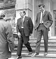 Tommy Roberts, head of the N Ireland Government Information Service, left, and Brian Cummings, private secretary to N Ireland Prime Minister, Brian Faulkner, are door-stepped by journalists as they emerge from Stormont Castle, Belfast. 18th June 1971. 197106180236..Copyright Image from Victor Patterson, 54 Dorchester Park, Belfast, UK, BT9 6RJ..Tel: +44 28 9066 1296.Mob: +44 7802 353836.Voicemail +44 20 8816 7153.Skype: victorpattersonbelfast.Email: victorpatterson@me.com.Email: victorpatterson@ireland.com (back-up)..IMPORTANT: If you wish to use this image or any other of my images please go to www.victorpatterson.com and click on the Terms & Conditions. Then contact me by email or phone with the reference number(s) of the image(s) concerned.
