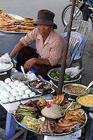 Phnom Penh, Cambodia. Street vendors and food stalls.