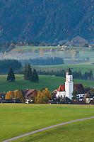 Church tower rises above village of Zell during autumn, Allgäu region, Bavaria, Germany
