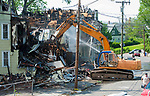 WATERBURY,  CT-051817JS22-Workers from Ocean Trace Demolition on Watertown on Thursday, tear down three of the four house destroyed by fire on Lounsbury Street  in Waterbury.  <br /> Jim Shannon Republican-American