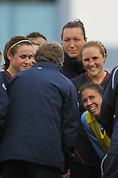 US Coach Pia Sundhage (back facing camera) talks to US players (R to L) Heather O'Reilly, Jill Loyden and Rachel Buehler and Shannon Boxx (crouching) after a game vs Iceland at the 2010 Algarve Cup in Portugal.