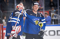 Finnish goalkeeper Harri Sateri (L) and Lasse Kukkonen happy after the Ice Hockey World Championship quarter-final match between the US and Final in the Lanxess Arena in Cologne, Germany, 18 May 2017. Photo: Marius Becker/dpa /MediaPunch ***FOR USA ONLY***