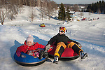 Happy Smiling Young Kid and Mother on Otepää Snowtubing Track, Valga County, Estonia