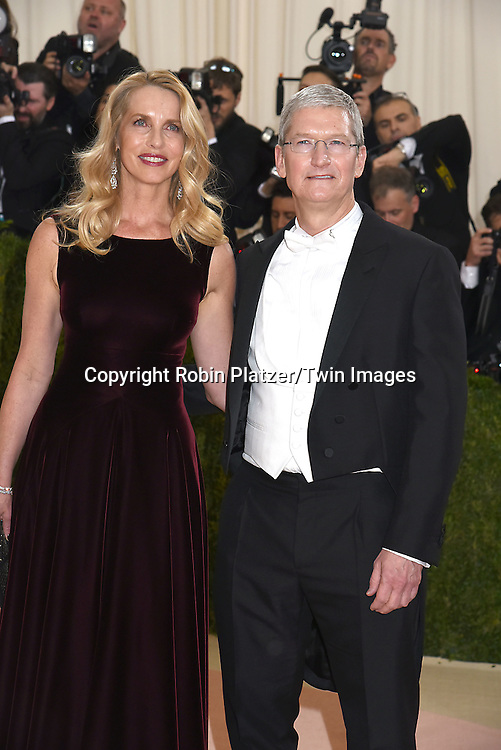 Tim Cook and Steve Jobs wife Laurene Powell Jobs  attend the Metropolitan Museum of Art Costume Institute Benefit Gala on May 2, 2016 in New York, New York, USA. The show is Manus x Machina: Fashion in an Age of Technology. <br /> <br /> photo by Robin Platzer/Twin Images<br />  <br /> phone number 212-935-0770