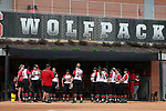 RALEIGH, NC - MARCH 29: NC State's players wait for player introductions. The North Carolina State University Wolfpack hosted the Liberty University Flames on March 29, 2017, at Dail Softball Stadium in Raleigh, NC in a Division I College Softball game. Liberty won the game 5-3.