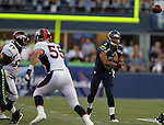 Seattle Seahawks quarterback Russell Wilson passes against the Denver Broncos Wesley Woodyard at CenturyLink Field in Seattle, Washington on  August 17, 2013. The Seattle Seahawks beat the Broncos 40-10.     ©2013. Jim Bryant Photo. All Rights Reserved.