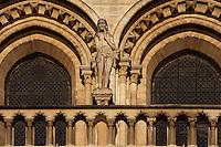 Eve, on the right side of the large rose, rebuilt by Viollet-le-Duc in the 19th century, West façade, Notre Dame de Paris, 1163 ? 1345, initiated by the bishop Maurice de Sully, Ile de la Cité, Paris, France. Picture by Manuel Cohen