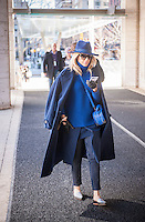 Fashionistas brave the frigid weather wearing their fashionable winter clothing outside the Fall 2015 Fashion Week shows in Lincoln Center in New York on Friday, February 13, 2015. The day started off in the single digits reaching the mid-teens and Sunday is expected to go down to zero, the coldest day in the city in 20 years. This is the last time the shows will be at Lincoln Center as they were booted after a lawsuit was won about them denying use of the park to the public. A new venue has not been determined yet. (© Richard B. Levine)