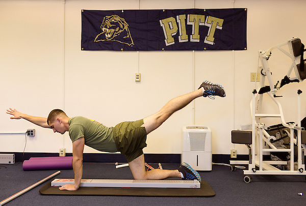 October 21, 2014. Camp LeJeune, North Carolina.<br />  Cpl. Brian Sears, age 22, runs through a series of strength and balance tests conducted by the University of Pittsburgh. UPITT is in charge of the medical testing section of the GCEITF.<br />  The Ground Combat Element Integrated Task Force is a battalion level unit created in an effort to assess Marines in a series of physical and medical tests to establish baseline standards as the Corps analyze the best way to possibly integrate female Marines into combat arms occupational specialities, such as infantry personnel, for which they were previously not eligible. The unit will be comprised of approx. 650 Marines in total, with about 400 of those being volunteers, both male and female. <br />  Jeremy M. Lange for the Wall Street Journal<br /> COED