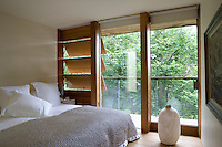 All the bedrooms open onto a connecting balcony and wooden ventilation slats provide fresh air