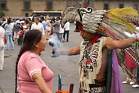 Shaman performing a traditional limpia or cleansing on a woman in Mexico City's Zocalo