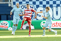 Blas Perez FC Dallas forward watched by Matt Besler Sporting KC... Sporting KC defeated FC Dallas 2-1 at LIVESTRONG Sporting Park, Kansas City, Kansas.