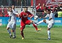 30 March 2013:Toronto FC midfielder John Bostock #7 battles for a ball with Los Angeles Galaxy midfielder Michael Stephens #26 and Los Angeles Galaxy midfielder Juninho #19 during an MLS game between the LA Galaxy and Toronto FC at BMO Field in Toronto, Ontario Canada..The game ended in a 2-2 draw..