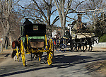 "Carriages pass on Colonial Williamsburg street Virginia, wagon, carriage, Colonial Williamsburg Virginia is historic district 1699 to 1780 which made colonial Virgnia's Capital, for most of the 18th century Williamsburg was the center of government education and culture in Colony of Virginia, George Washington, Thomas Jefferson, Patrick Henry, James Monroe, James Madison, George Wythe, Peyton Randolph, and others molded democracy in the Commonwealth of Virginia and the United States, Motto of Colonial Williamsburg is ""The furture may learn from the past,"""