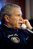 Aboard Air Force One - July 14, 2006 -- United States President George W. Bush calls several world leaders concerning the situation in the Middle East from his Air Force One office en route to the G8 Summit in St. Petersburg, Russia, Friday, July 14, 2006. .Credit: Eric Draper - White House via CNP.