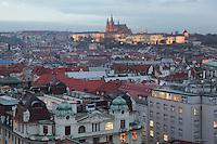 Evening view over the city of Prague, with Prague Castle, 10th - 14th centuries, the largest ancient castle in the world, and St Vitus cathedral, a Gothic Roman catholic cathedral founded 1344, in the distance, Prague, Czech Republic. The historic centre of Prague was declared a UNESCO World Heritage Site in 1992. Picture by Manuel Cohen