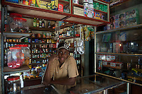 Young man at his grocery store on the Indian Ocean island of Rodrigues.